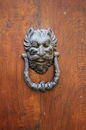 Old iron Door knoker on an old wodden door photo