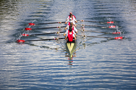 team sports: Rowers in eight-oar rowing boats on the tranquil lake