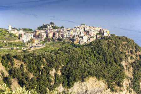 Corniglia is one of five famous colorful villages of Cinque Terre in Italy. photo