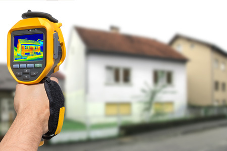 thermal: Recording Heat Loss at the House With Infrared Thermal Camera Stock Photo