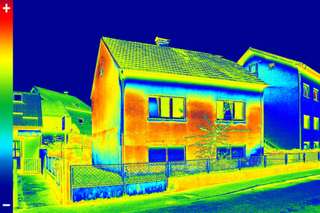 Infrared thermovision image showing lack of thermal insulation on House Stock fotó - 32497881