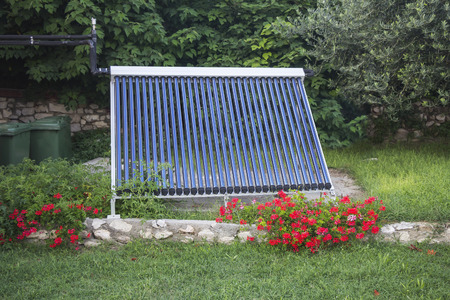 Vacuum solar water heating system in the yard house photo