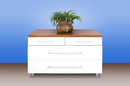 chest of drawers: Modern white wooden chest of drawers, blue wall background