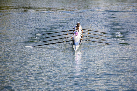 sculling: Rowers in eight-oar rowing boats on the tranquil lake