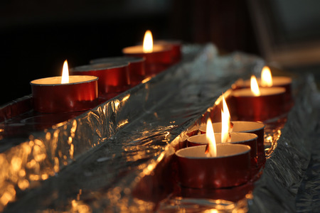 A group of burning candles in the church photo