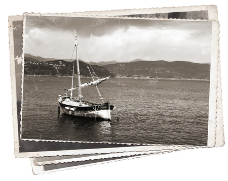 Vintage photos Old wooden sail ship, docked in the port of Portofino, Italy photo