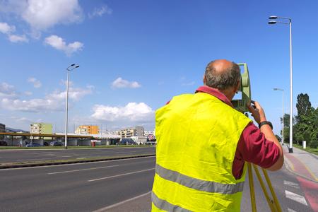 tachymeter: Surveyor engineer worker making measuring with theodolite equipment