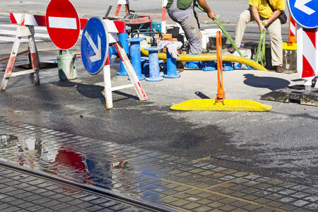 Repair and replacement of water pipes in the street photo