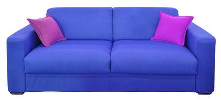 Blue two-seat sofa with pillows, isolated on white background photo