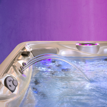 Jacuzzi Bathtub filling up with clean water from a three faucet photo