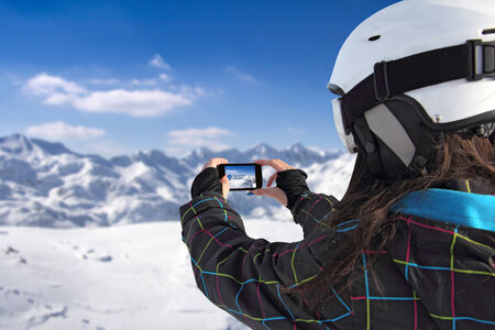 ski jump: Photographing winter landscape mountains and snow, with cell phone