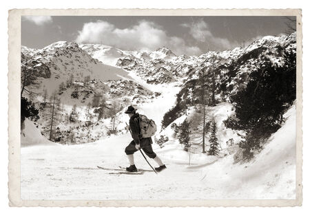 Vintage photos old skier with traditional old wooden skis photo