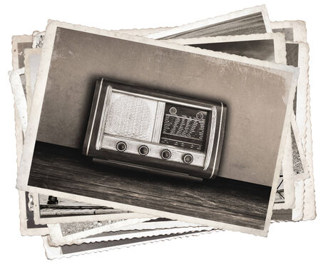 Old photos vitange fashioned radio on wooden table