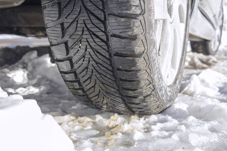 Winter tyres of a cars on a snowy road photo