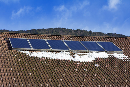 solarpanel: Photovoltaic Solar Panels on the roof House Stock Photo