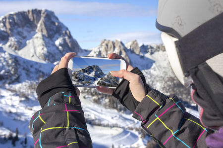 outdoor photo: Photographing winter landscape mountains and snow, with cell phone