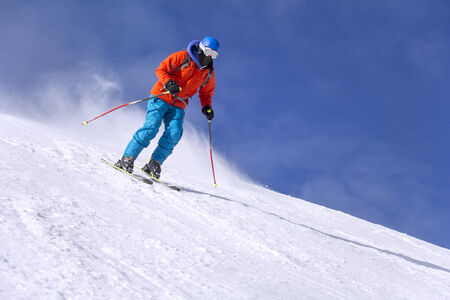 ski jump: Skier skiing downhill in high mountains and sunny day
