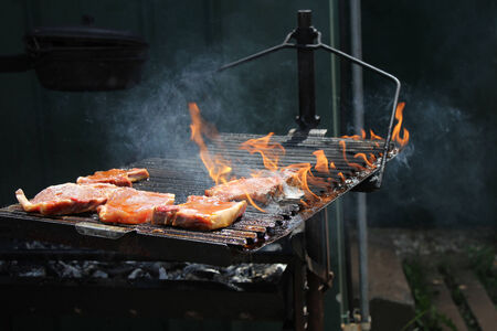 charcoal grill: Roast pork chops on the grill on flame