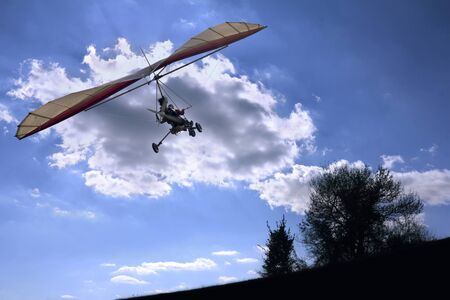 motorized: The motorized hang glider flying to the sun