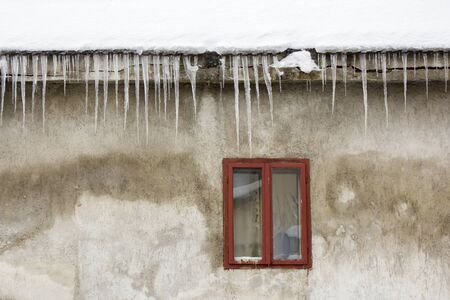 bric: Icicles hanging off a roof in the winter Stock Photo