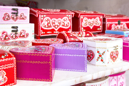 souvenir traditional: Wooden gift boxes painted with traditional Croatian decorations, as souvenir Stock Photo