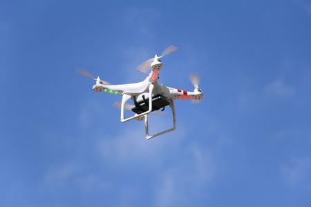 Radio controlled quadcopter drone with with mounted smartphone camera.