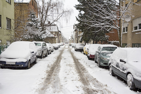 winter weather: Cars parked on the street covered with fresh snow