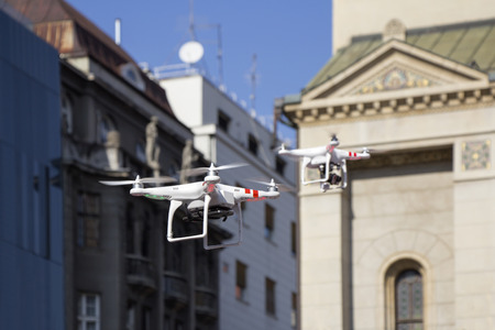 controlled: Two Radio controlled quadcopter drone flying in the city
