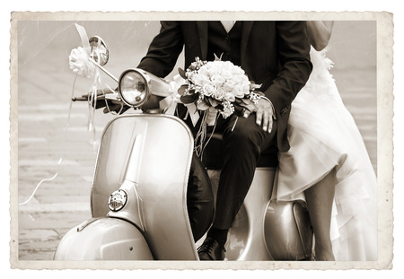 Vintage photo with Young newlywed just married, posing on an old gray scooter