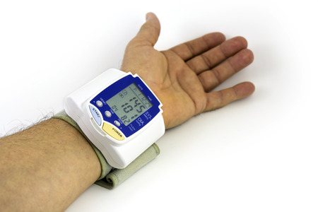 own blood: Man himself measured his own blood pressure on a wrist Stock Photo