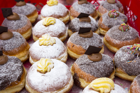 Various Warm and sweet donuts in a market bakery