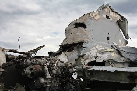 Crashed military plane, part of the engine and tail plane Stockfoto