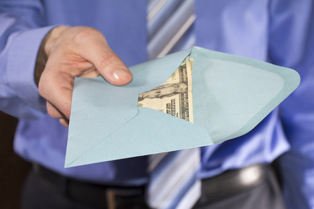 bribe: Man in a blue shirt, giving bribe in a blue envelope