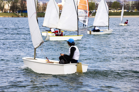 sailing boat: Small boats sailing on the lake on a beautiful sunny day Stock Photo