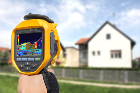 thermal imaging: Recording Heat Loss at the House With Infrared Thermal Camera Stock Photo