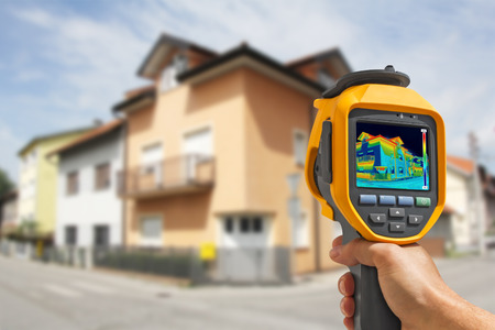 thermogram: Recording Heat Loss at the House With Infrared Thermal Camera Stock Photo