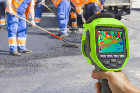 asphalting: Recording Workers on Asphalting and Repair of roads With Infrared Thermal Camera