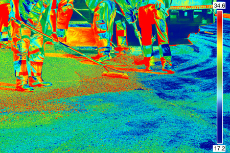 thermal imaging: Thermovision Infrared image of Workers on Asphalting roads
