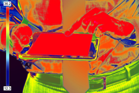 thermal imaging: Thermovision Infrared image of Businessman With tablet Stock Photo