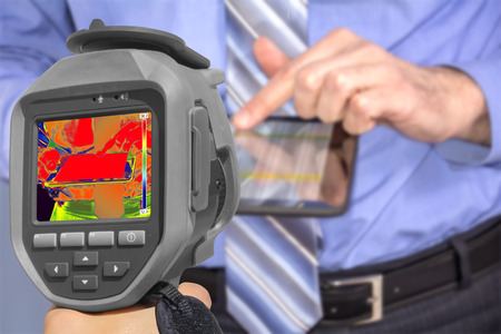 thermogram: Recording Businessman With tablet using Infrared Thermal Camera