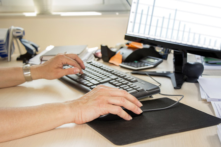 computer keyboards: Business woman working on computer in office Stock Photo