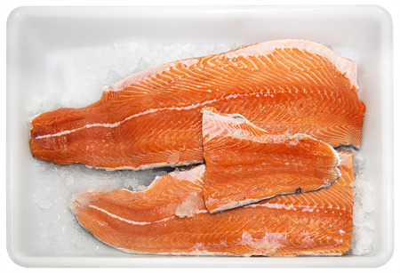 Fresh Fillet of salmon on ice in a market photo