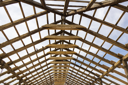 roof framework: Wood house roof skeleton under construction