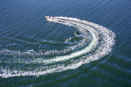 Powerboat and his trace on the blue sea