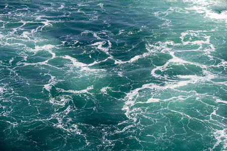 seawater: Turquoise green Seawater with sea foam as background Stock Photo