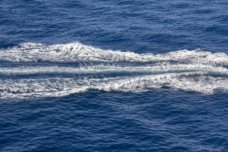 Trace of Speed boats on the blue sea Stock Photo