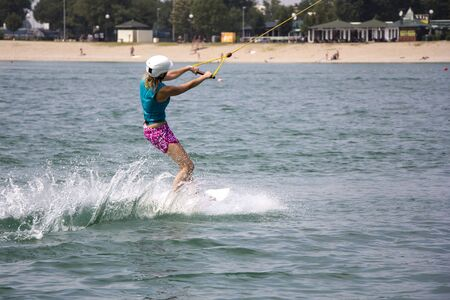 action girl: Young girl wakeboarder in action on the lake
