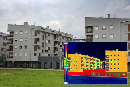 Residential building with Infrared thermovision image showing lack of thermal insulation