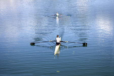 sculling: Two Young rowers training rowing on the Lake