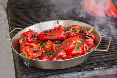 Roasting red peppers on a outdoor grill